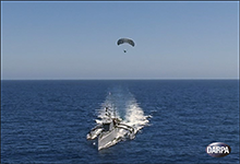 Image Caption: DARPA's Anti-Submarine Warfare (ASW) Continuous Trail Unmanned Vessel (ACTUV) program has developed and built a technology demonstration vessel that is currently undergoing open-water testing off the coast of California and recently set sail with its first payload: a prototype of a low-cost, elevated sensor mast developed through the Agency's Towed Airborne Lift of Naval Systems (TALONS) research effort. Click below for high-resolution image.