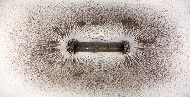 Image Caption: An iconic visualization of otherwise invisible magnetic field lines associated with a bar magnet hints of the far weaker biology-based magnetic fields from hearts and brains that DARPA's new AMBIIENT program aims to measure with unprecedented ease.