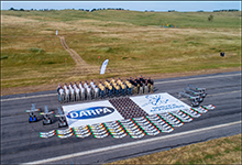 U.S. Air Force Academy (left), U.S. Naval Academy (center), and U.S. Military Academy (right) teams and their unmanned aerial vehicles (UAVs) at the DARPA Service Academies Swarm Challenge